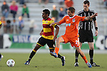 20 April 2013: Fort Lauderdale's Pecka (BRA) (8) and Carolina's Brian Shriver (21) are watched by referee Daniel Fitzgerald. The Carolina RailHawks played the Fort Lauderdale Strikers at WakeMed Stadium in Cary, North Carolina in a North American Soccer League Spring 2013 Season regular season game.