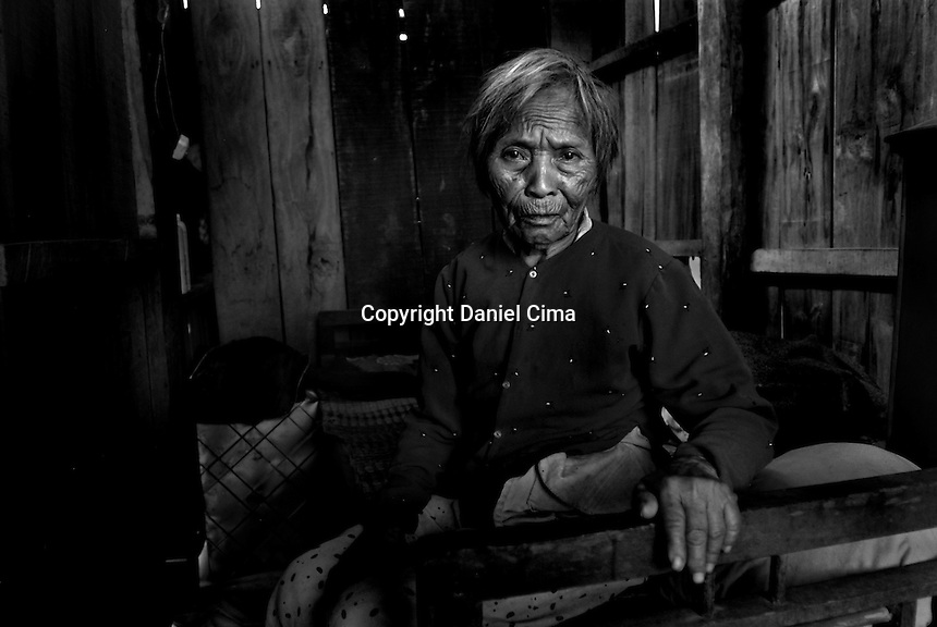 Portrait of an old woman (typhoon surviver) at home in .Da-Nang, The Socialist Republic of Vietnam. May 2007