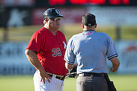 Kannapolis Intimidators manager Tommy Thompson (39) has a discussion with home plate umpire Grant Conrad between innings of the game against the Asheville Tourists at Intimidators Stadium on June 28, 2015 in Kannapolis, North Carolina.  The Tourists defeated the Intimidators 6-4.  (Brian Westerholt/Four Seam Images)