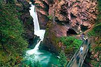 Waterfall and walkway in Johnstone Canyon, Banff National Park, Alberta, Canada.