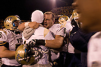 Pitt center Chris Vangas hugs injured quarterback Bill Stull (face not visible) after the Pitt Panthers upset the West Virginia Mountaineers 13-9 on December 01, 2007 at Mountaineer Field, Morgantown, West Virginia.