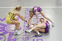 04 MAY 2007 - LOUGHBOROUGH, UK - Olivia Murphy dives over team mate Becky James for a loose ball as Charlotte Hennison looks on - Loughborough Lightning (Purple) v Northern Thunder (Yellow). (PHOTO (C) NIGEL FARROW)
