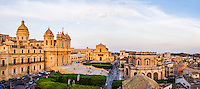 Panoramic photo of Noto showing St Nicholas Cathedral (Noto Cathedral, Cattedrale di Noto), Church of San Salvatore (Basilica San Salvatore) and Town Hall (Municipio) in Piazza del Municipio, Noto, Sicily, Italy, Europe. This is a panoramic photo of Noto showing St Nicholas Cathedral (Noto Cathedral, Cattedrale di Noto), Church of San Salvatore (Basilica San Salvatore) and Town Hall (Municipio) in Piazza del Municipio, Noto, Sicily, Italy, Europe.