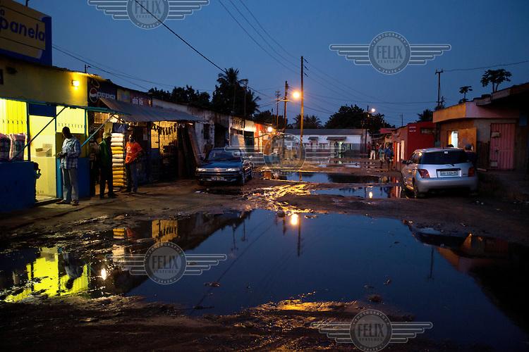 A flooded street in a Maputo Bairro.
