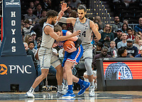 WASHINGTON, DC - DECEMBER 28: Jagan Mosely #4 of Georgetown blocks Mark Gasperini #23 of American during a game between American University and Georgetown University at Capital One Arena on December 28, 2019 in Washington, DC.