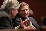 Nevada Sens. Tick Segerblom, D-Las Vegas, left, and Greg Brower, R-Reno, talk on the Senate floor at the Legislative Building in Carson City, Nev., on Tuesday, April 16, 2013. .Photo by Cathleen Allison