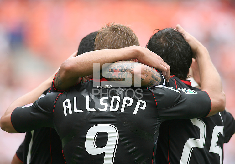 Danny Allsopp #9 of D.C. United receives congratulations after scoring during an MLS match against the Philadelphia Union at RFK Stadium on August 22 2010, in Washington DC. United won 2-0.