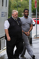 "Pictured: Sochi Ezeemo (R) arrives at Cardiff Crown Court, Cardiff, Wales, UK. Friday 27 September 2019<br /> Re: Two men who handcuffed another to a radiator for over 24hrs have are due to be sentenced by Cardiff Crown Court, Wales, UK.<br /> Peter Shodeinde and Sochi Ezeemo, both 27, collected the man from Bristol and brought him to a house in Treforest. <br /> Ezeemo contacted the brother of the victim in Nigeria demanding money they said was owed to them. Police in the UK were contacted by the victim's brother telling them about the demands. <br /> When police raided the house where they believed the victim was being held prisoner, they found him injured and handcuffed to a radiator.  <br /> Shodeinde claimed that he was part not of the kidnapping and false imprisonment but evidence presented by the CPS was able to prove that he was. <br /> Kelly Huggins, of the CPS, said: ""The victim suffered appalling treatment whilst being kept prisoner, being beaten, deprived of sleep and enduring acts of humiliation such as shaving off his hair.<br /> ""It is difficult to imagine how frightening this horrible experience would have been for the victim.<br /> ""Now that the case has concluded, we hope it will help him move forward in his healing process."""