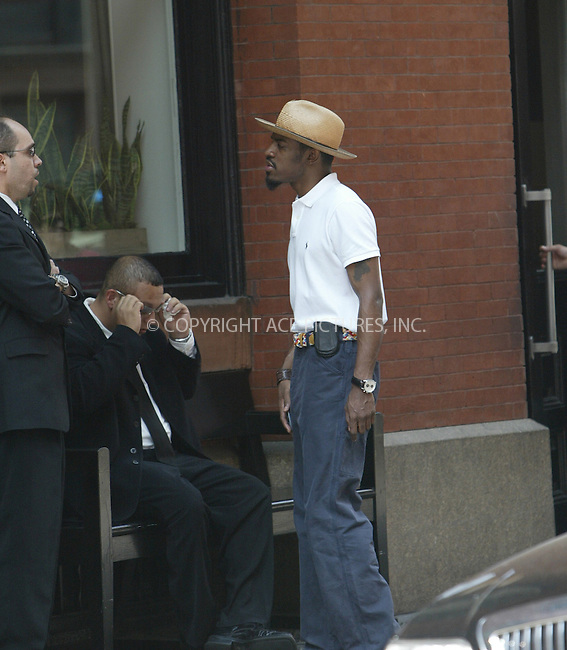 WWW.ACEPIXS.COM . . . . .  ....NEW YORK, JULY 25, 2005....Andre 3000 seen walking in SoHo is in town to promote his new movie 'Four Brothers.' Unfortunately Andre 3000 uses his hands, his cell phone and passing shoppers to avoid having his picture taken.....Please byline: JENNIFER L GONZELES-ACE PICTURES.... *** ***..Ace Pictures, Inc:  ..Craig Ashby (212) 243-8787..e-mail: picturedesk@acepixs.com..web: http://www.acepixs.com