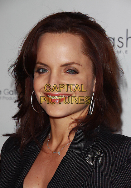 MENA SUVARI.Brand Equity Showroom Runway Show-Arrivals  held at the Sunset Gower Studios,  Los  Angeles, California, USA..March 21st, 2010.headshot portrait black silver hoop earrings red lipstick .CAP/ADM/TC.©T. Conrad/AdMedia/Capital Pictures.