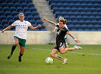 FC Gold Pride forward Kelly O'Hara (7) takes a shot while being defended by Red Stars defender Whitney Engen (9).  The FC Gold Pride defeated the Chicago Red Stars 3-2 at Toyota Park in Bridgeview, IL on August 22, 2010