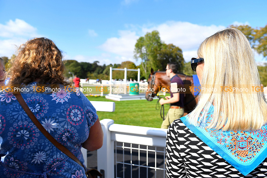 Racegoers admire the horses in the Parade Ring during Afternoon Racing at Salisbury Racecourse on 3rd October 2018