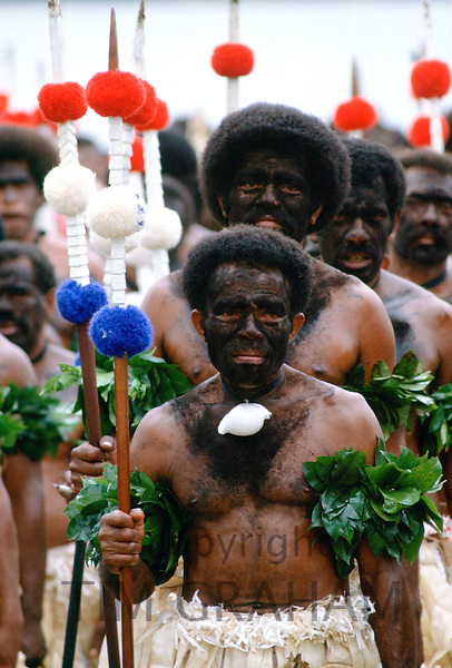 Fijian warriors faces painted black in the traditional manner while attending a tribal gathering in Fiji, South Pacific