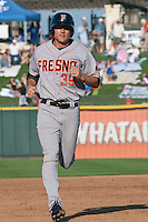Fresno Grizzlies outfielder Roger Kieschnick #39 trots around the bases during the Pacific Coast League baseball game against the Round Rock Express on May 19, 2012 at The Dell Diamond in Round Rock, Texas. The Grizzlies defeated the Express 10-4. (Andrew Woolley/Four Seam Images).