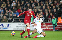 Kyle Naughton of Swansea City tackles Andrew Robertson of Liverpool during the Premier League match between Swansea City and Liverpool at the Liberty Stadium, Swansea, Wales on 22 January 2018. Photo by Mark Hawkins / PRiME Media Images.