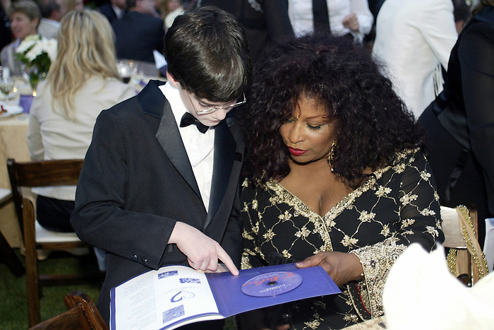 21 May 2005: 13 yr. old jazz pianist Matt Savage goes over lyrics with Chaka Khan at the 2nd Annual Gala Dinner benefiting the Chaka Khan Foundation in Beverly Hills, CA. .Mandatory Credit: Juliann Tallino