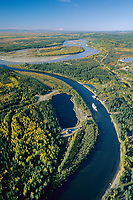 Aerial of Fairbanks, Alaska, Tanana and Chena River confluence, Alaska mountain range on horizon, Mt. Denali visible on the right, sternwheeler river boat discovery on the Chena River.