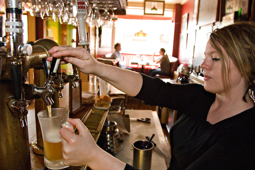 A waitress pours a Blueberry Wheat Ale at The Vierling Restaurant and Marquette Harbor Brewery in downtown Marquette Michigan.