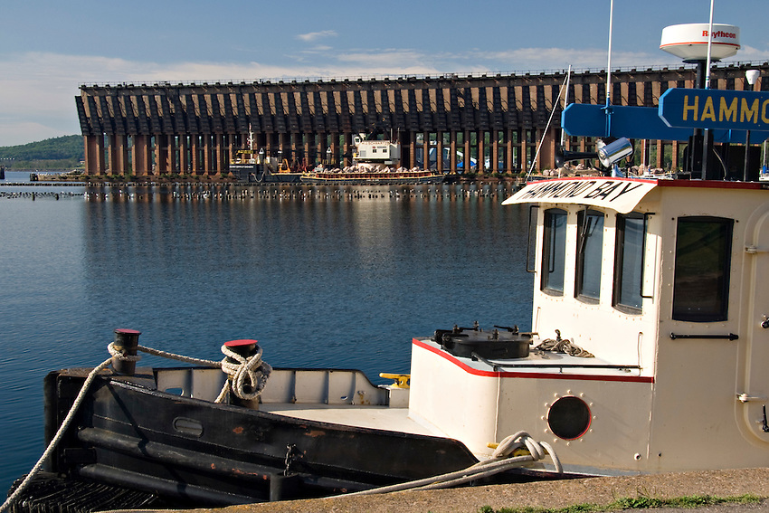 Tugs and a barge in the lower harbor of Marquette Michigan on Lake Superior.