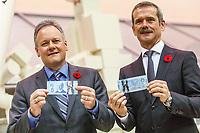 L'astronaute Chris Hadfield et Stephen S. Poloz lors du devoilement d'un nouveau billet de 5 $ mettant en vedette le Bras Canadien, le 7 novembre 2013, a l'Agence Spatiale Canadienne.<br /> <br /> PHOTO : Agence Quebec Presse