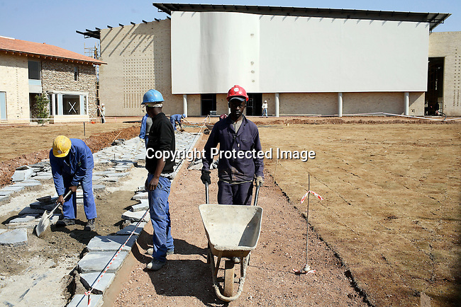 """JOHANNESBURG, SOUTH AFRICA AUGUST 10: Construction worker at the site of Oprah's school """"Oprah Winfrey Leadership Academy for Girls"""" located about 40 miles south of Johannesburg in Henley-on-Klip, Meyerton. Oprah visited South Africa to interview girls and to inspect the construction of the school. (Photo by Per-Anders Pettersson)..."""