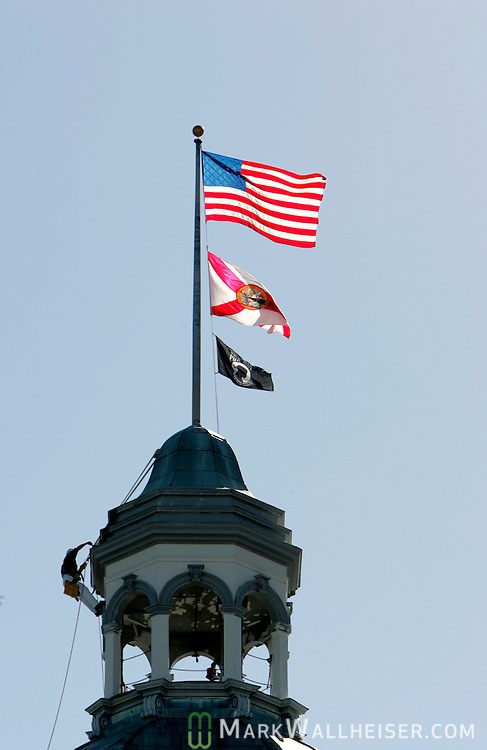 A man paints the cupala of the old Florida State capitol building in downtown Tallahassee, Florida November 15, 2004.   (Mark Wallheiser/TallahasseeStock.com)