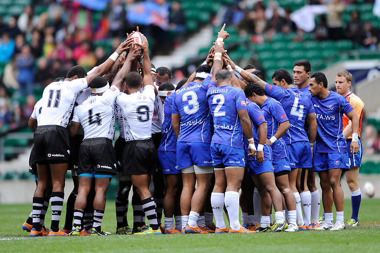 Fiji and Samoa prepare for their Cup quarter final match during Day Two of the iRB Marriott London Sevens at Twickenham on Sunday 11th May 2014 (Photo by Rob Munro)