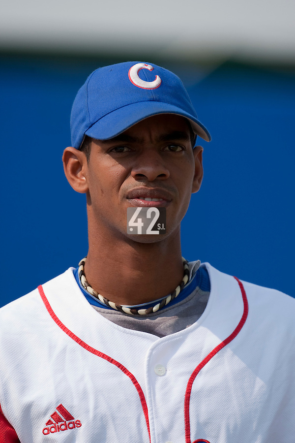 27 September 2009: Hector Olivera of Cuba is warms up prior to the 2009 Baseball World Cup gold medal game won 10-5 by Team USA over Cuba, in Nettuno, Italy.
