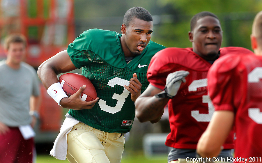 TALLAHASSEE, FLA. 3/26/11-FSU032611 CH-EJ Manuel runs through a play during practice Saturday in Tallahassee..COLIN HACKLEY PHOTO