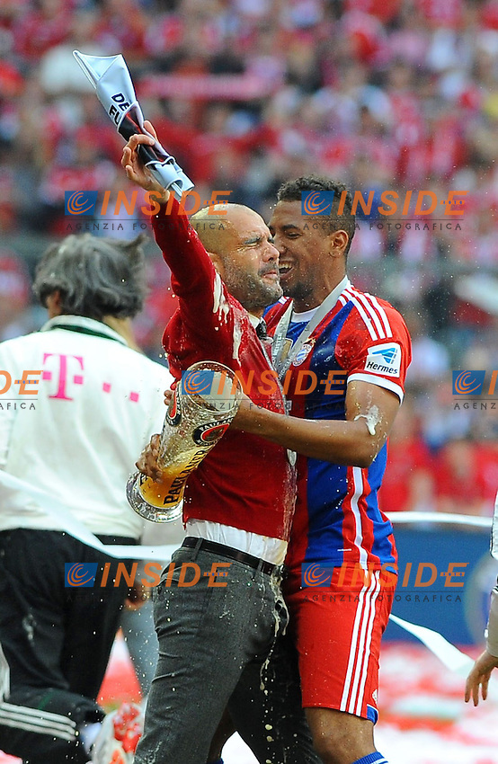 10.05.2014, Allianz Arena, Muenchen, GER, 1. FBL, FC Bayern Muenchen vs VfB Stuttgart, 34. Runde, im Bild Riesenfreude bei Trainer Pep Guardiola (FC Bayern Muenchen) und Jerome Boateng (FC Bayern Muenchen) // during the German Bundesliga 34th round match between FC Bayern Munich and VfB Stuttgart at the Allianz Arena in Muenchen, Germany on 2014/05/10. EXPA Pictures &copy; 2014, PhotoCredit: EXPA/ Eibner-Pressefoto/ Stuetzle<br /> <br /> *****ATTENTION - OUT of GER***** <br /> Football Calcio 2013/2014<br /> Bundesliga 2013/2014 Bayern Campione Festeggiamenti <br /> Foto Expa / Insidefoto