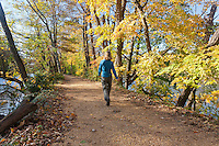 Hiker on the towpath, Delaware and Raritan Canal State Park, New Jersey