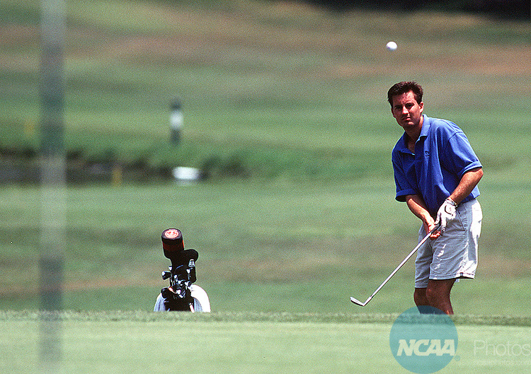 22 MAY 1998: Lee Kinney of CSU San Bernadino watches his chip shot sail toward the pin during the Division II Men's Golf Championships held at the Mission Inn Golf and Tennis Resort in Lake Co., Florida. Orjan Larsen of the West Florida University took home the individual championship, while Florida Southern University captured the team title. Neil Desai/NCAA Photos