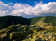 Cumulus clouds over West Bond (left) and Mout Bond (right) from the summit of Bondcliff in the Pemigewasset Wilderness of the New Hampshire White Mountains.