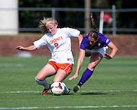 Makenzy Doniak (9) of Virginia is fouled by Jenna Weston (20) of Clemson at Klockner Stadium in Charlottesville, VA.  Virginia defeated Clemson, 3-0.