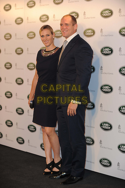 Zara Phillips, Mike Tindall.The All New Range Rover launch at the Royal Ballet School in Richmond Park, London, England..6th September 2012.full length black dress suit married husband wife .CAP/CAS.©Bob Cass/Capital Pictures.