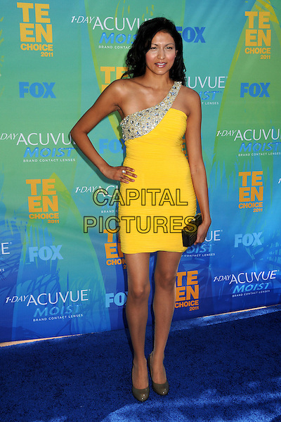 Tinsel Korey.2011 Teen Choice Awards - Arrivals held at Gibson Amphitheatre, Universal City, California, USA..August 7th, 2011.full length hand on hip silver embellished jewel encrusted dress yellow one shoulder black clutch bag.CAP/ADM/BP .©Byron Purvis/AdMedia/Capital Pictures.