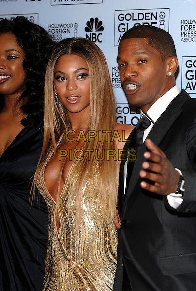 JENNIFER HUDSON, BEYONCE KNOWLES & JAMIE FOXX.Best musical or comedy motion picture award (Dreamgirls).Best Supporting Actress in a Motion Picture (Jennifer Hudson) .Pressroom - 64th Annual Golden Globe Awards, Beverly Hills HIlton, Beverly Hills, California, USA. .January 15th 2007.globes half length gold dress plunging neckline hand cleavage black suit jacket .CAP/PL.©Phil Loftus/Capital Pictures