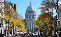 The Wisconsin State Capitol Building is seen through the fall colors of the trees lining State Street on Saturday, October 17, 2015 in Madison, Wisconsin