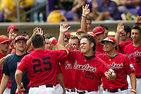 Stony Brook Seawolve bench greets teammate Kevin Courtney #25 as he crosses home plate after his home run in the NCAA Super Regional baseball game against LSU on June 9, 2012 at Alex Box Stadium in Baton Rouge, Louisiana. Stony Brook defeated LSU 3-1. (Andrew Woolley/Four Seam Images)
