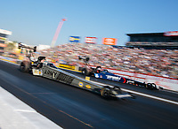Nov 11, 2018; Pomona, CA, USA; NHRA top fuel driver Tony Schumacher (near) races alongside Blake Alexander during the Auto Club Finals at Auto Club Raceway. Mandatory Credit: Mark J. Rebilas-USA TODAY Sports