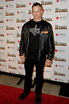 GARY SINISE. Arrivals to a special reading of 110 Stories, with proceeds to benefit the Red Cross at the Geffen Playhouse. Los Angeles, CA, USA. February 22, 2010. .