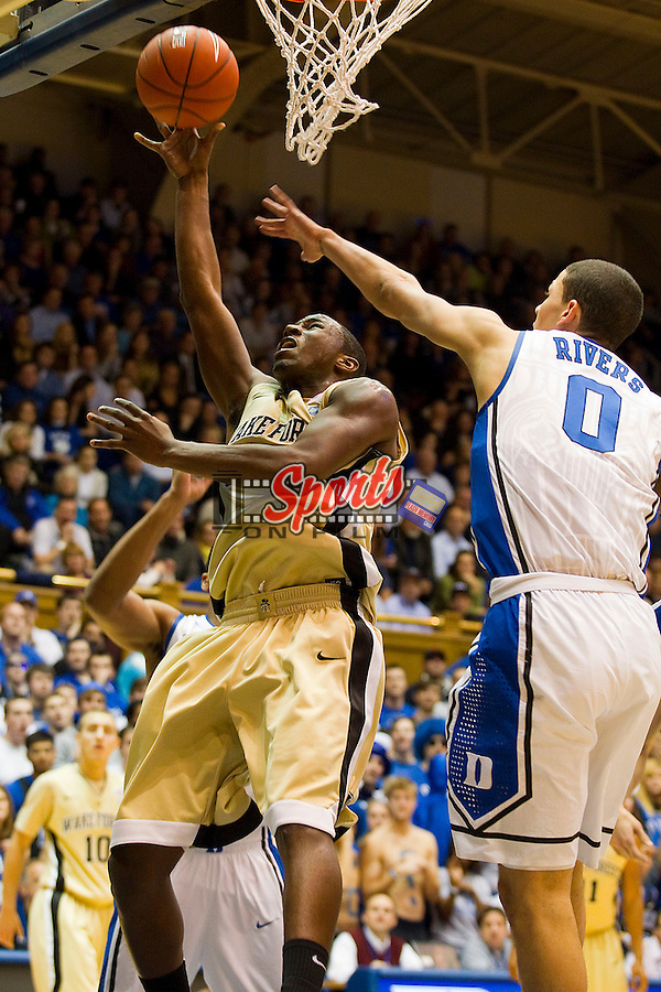 Travis McKie #30 of the Wake Forest Demon Deacons drives to the basket past Austin Rivers #0 of the Duke Blue Devils at Cameron Indoor Stadium on January 19, 2012 in Durham, North Carolina.  The Blue Devils defeated the Demon Deacons 91-73.  (Brian Westerholt / Sports On Film)