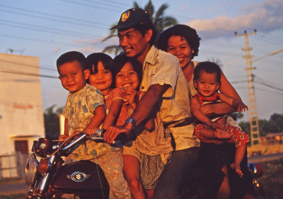 Lao family of six ride a motor cycle in Vientiane.