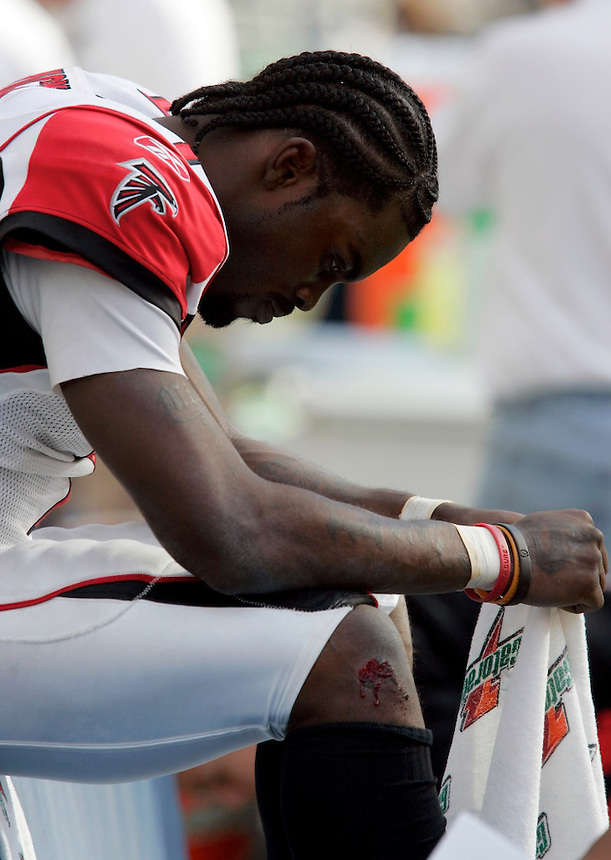 Atlanta's QB Michael Vick sits on the sidelines as the last few seconds tick off the clock of the Seahawks home opener against Atlanta Falcons at Qwest Field in Seattle, Washington on Sunday Sept. 18, 2005(Kevin P. Casey/Wireimage.com)