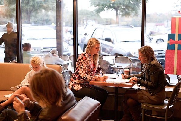 November 27, 2012. Charleston, South Carolina.. Alexa Wyatt, left, meets at a Starbucks with caterer Sarah Coffey of Newton Farms, of Kiawah.. Alexa Wyatt, 23, is an Event Coordinator with Southern Protocol, a boutique wedding and event planning company in Charleston, SC..