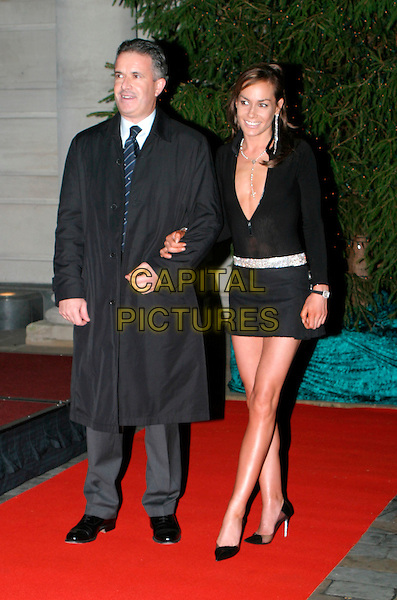 TARA PALMER TOMKINSON.lights the first ever Christmas tree at the Renaissance Chancery Court hotel.19/11/2003.full length, full-length, pleated miniskirt, kilt, plunging neckline, cleavage, diamante belt, stella mccartney shoes, heels, stilettos.www.capitalpictures.com.sales@capitalpictures.com.© Capital Pictures.