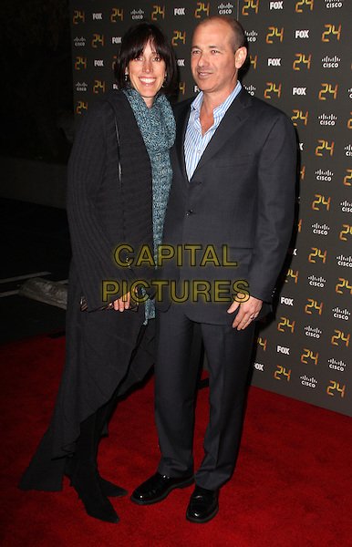 "KIM & HOWARD GORDON.""24"" 150th Episode & Season 7 Premiere Party held at XIV, Hollywood, California, USA..January 6th, 2009.full length black grey gray suit cardigan .CAP/ADM/KB.©Kevan Brooks/AdMedia/Capital Pictures."