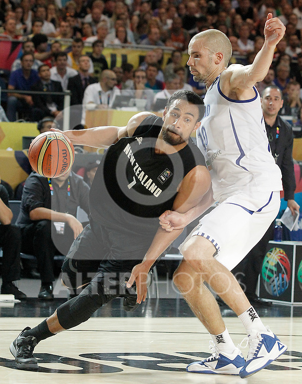 Findlan's Tuukka Kotti (r) and New Zealand's Mika Vukona during 2014 FIBA Basketball World Cup Group Phase-Group C match.September 4,2014.(ALTERPHOTOS/Acero)