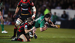 Rabo Direct Pro 12.Wayne Evans hauls down Mike McCarthy short of the try line..Newport Gwent Dragons v Connacht.30.03.12.©Steve Pope