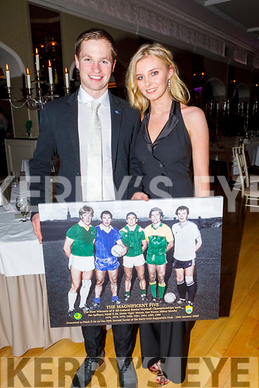 Padraig O'Se with Roisín Ní Bheaglaoi holding a photo of the Magnificent Five that was presented to him, at the Kerry Supporters Social in the Ballygarry House Hotel on Saturday